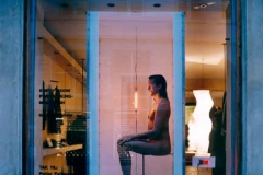 "C.""Empty room for thinking - Mindflash"". Photo: Karsten Damstedt Jørgensen. ""Windows of Culture"" : a project by Abby Weisgard. Windows of Culture"" : Birger Christensen a project by Abby Weisgard. Artist: Gunilla Leander (Sweden).People have the urge to break through boarders. Gunnila Leander is fascinated by the power within us that makes us persevere - makes us go forward in life. Her work is conceptual; her installation is an empty room -- a symbol for the starting point for the process of making art. In this empty room, a sudden and intense light flashed at random intervals. Sometimes a naked man came into the room, and no one ever knew when he was going to show up! He walked in as if shot in super-slow-motion, and sat so still that it was difficult to see if he was even alive. Then he slowly rose -- and disappeared."